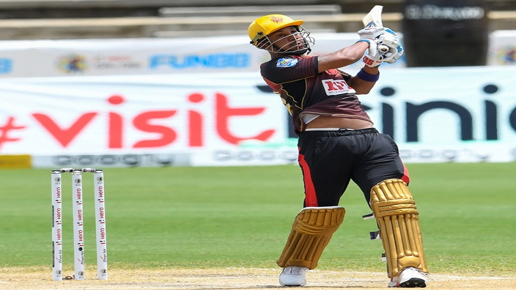 Lendl  Simmons  of  Trinbago  Knight  Riders  hits  a six  during  Match No. 23 of the  Hero  Caribbean  Premier League against St Kitts & Nevis Patriots at the Brian Lara Cricket Academy in Trinidad on Wednesday, September 2, 2020.  (Photo by Randy Brooks - CPL T20/CPL T20 via Getty Images).