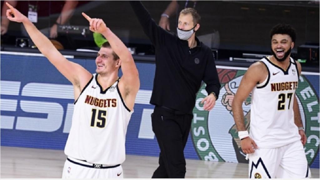Denver Nuggets pair Nikola Jokic (L) and Jamal Murray (R) celebrate.