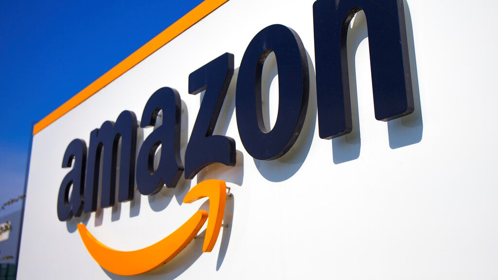 In this Thursday April 16, 2020 file photo, The Amazon logo is seen in Douai, northern France. (AP Photo/Michel Spingler, File)