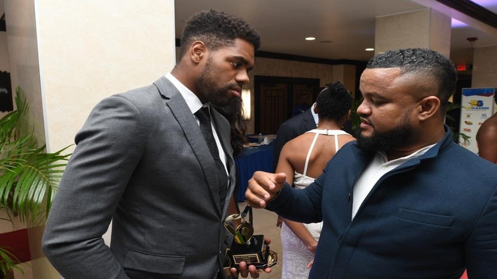 Ryan Foster (right), the JOA's CEO/general secretary, greets Jamaica's diver Yona Knight-Wisdom.