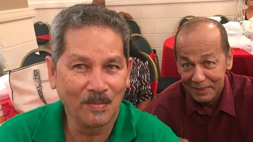 Sheldon Gomes (right) at a public function with brother Larry Gomes.