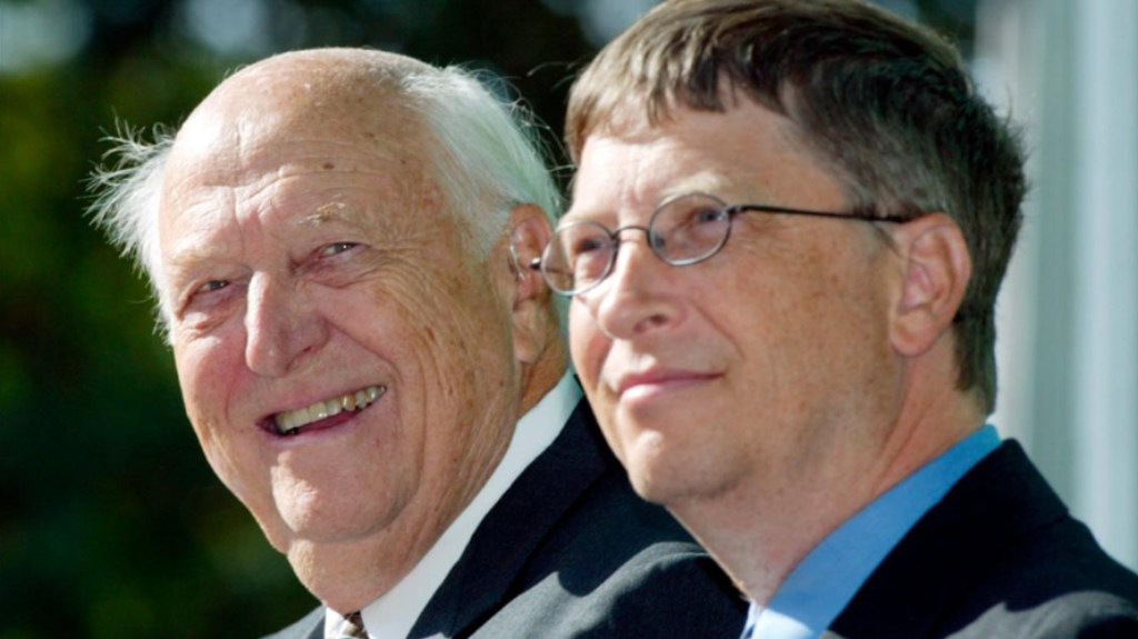 In this Sept. 12, 2003 file photo, William H. Gates Sr., left, smiles while sitting next to his son, Bill Gates Jr., during the dedication and grand opening of the William H. Gates Hall, new home of the University of Washington School of Law in Seattle. Bill Gates Sr., a lawyer and philanthropist and father of Microsoft co-founder Bill Gates, died Monday, Sept. 14, 2020, at age 94. (AP Photo/John Froschauer, File)