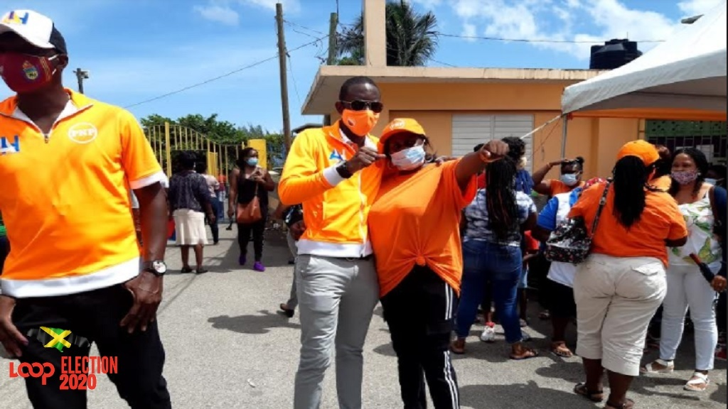 The PNP's Dr Andre Haughton (second left) speaks with a supporter in Mount Salem inMontego Bay,St Jamesafter casting his vote in the general elections on Thursday, September 3, 2020.