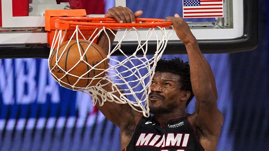 Miami Heat's Jimmy Butler dunks the ball during the second half of an NBA basketball conference semifinal playoff game against the Milwaukee Bucks on Monday, Aug. 31, 2020, in Lake Buena Vista, Fla. (AP Photo/Mark J. Terrill).