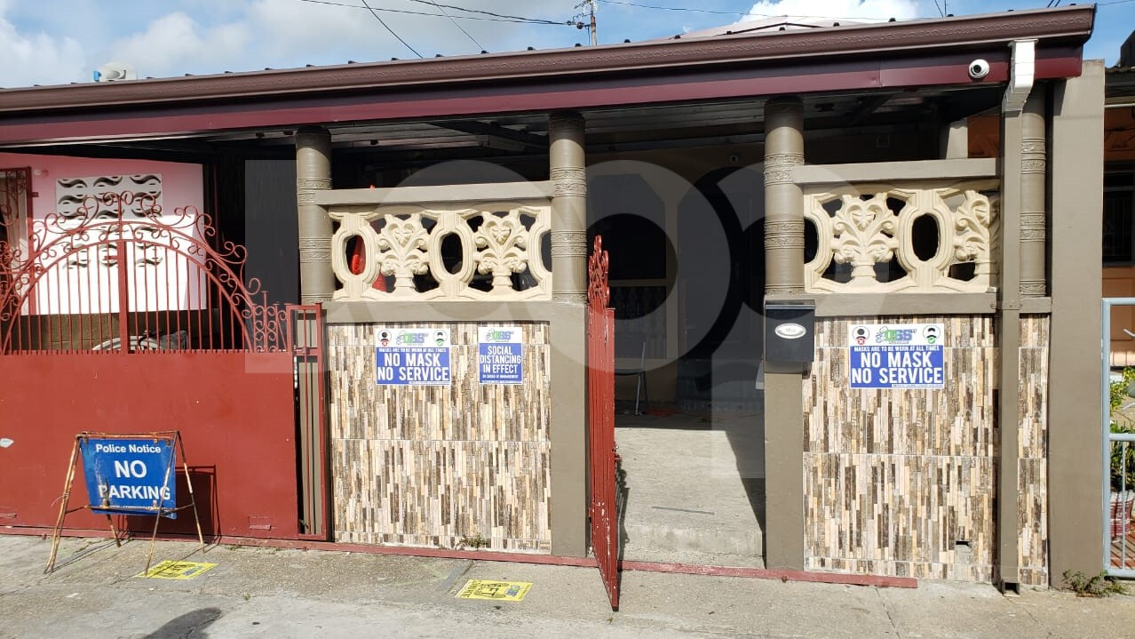 A home in La Horquetta where police searched and found $22 million.