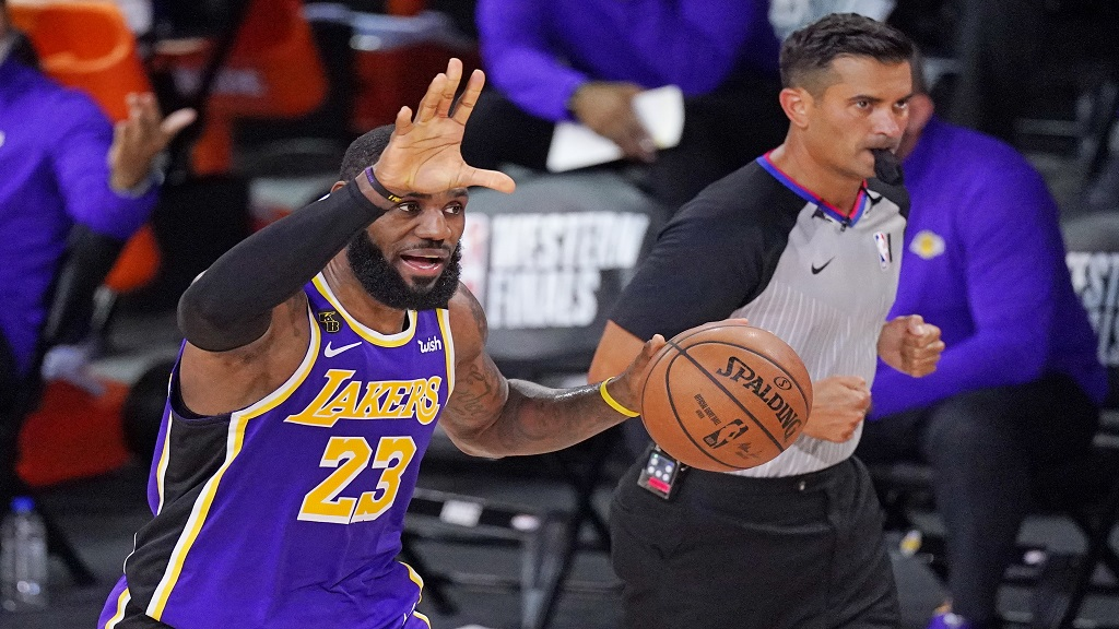 Los Angeles Lakers' LeBron James (23) brings the ball up the court during the second half of an NBA conference final playoff basketball game against the Denver Nuggets Saturday, Sept. 26, 2020, in Lake Buena Vista, Fla. (AP Photo/Mark J. Terrill).