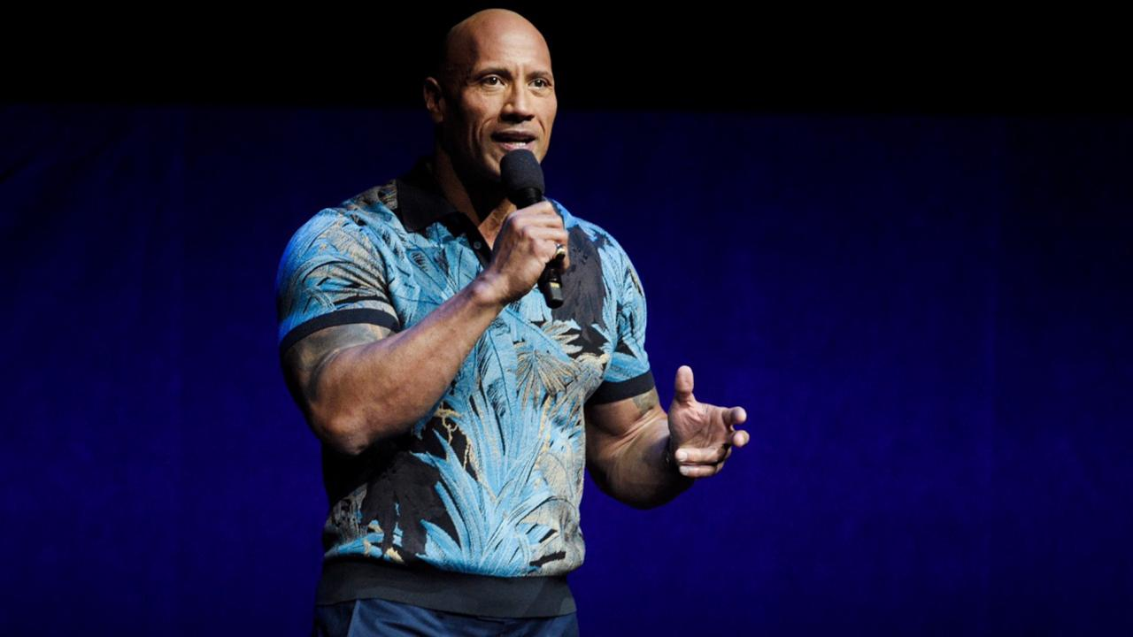 In this Wednesday, April 3, 2019, file photo, Dwayne Johnson speaks during the Universal Pictures presentation at CinemaCon 2019, the official convention of the National Association of Theatre Owners (NATO) at Caesars Palace, in Las Vegas. Johnson says he and his family tested positive for the coronavirus. Johnson announced their diagnosis in an 11-plus minute video on Instagram on Wednesday, Sept. 2, 2020. (Photo by Chris Pizzello/Invision/AP, File)