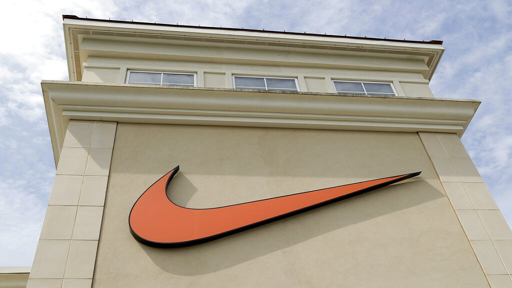 A Nike company logo is displayed outside a Nike store in Charlotte, N.C.  (AP Photo/Chuck Burton, file)