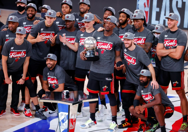 Les joueurs du Miami Heat célèbrent leur accession en finale de la NBA, le 27 septembre 2020 à Lake Buena Vista afp.com - Kevin C. Cox