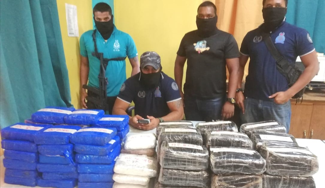 Officers of the Eastern Division's Special Division Unit display their million-dollar ganja haul in Sangre Grande.