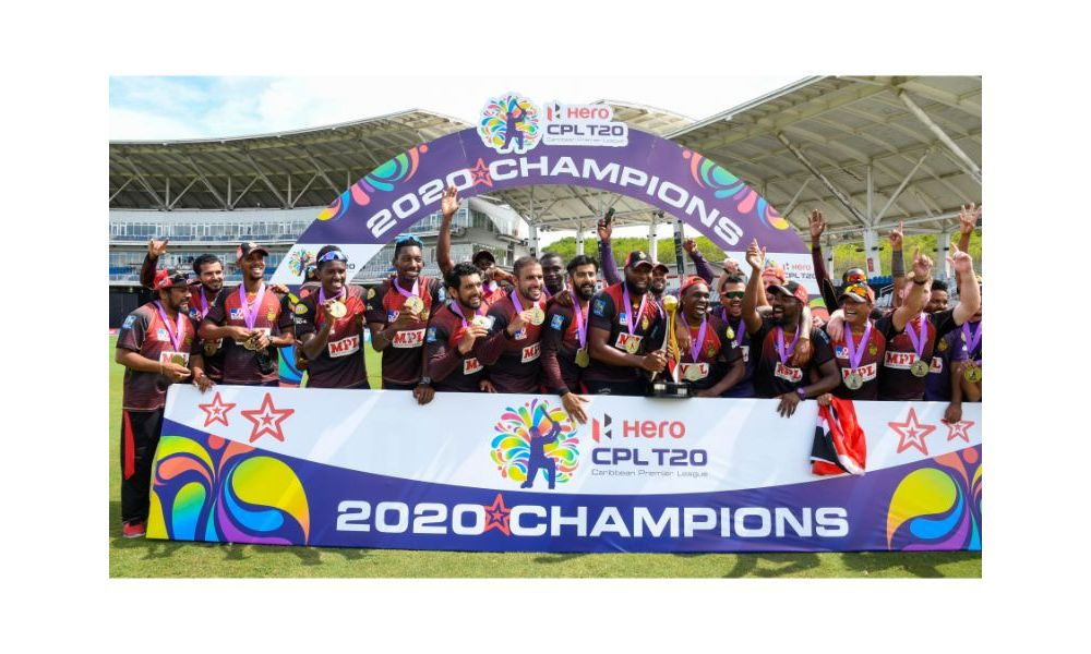 The Trinbago Knight Riders players and management staff pose with the Hero Caribbean Premier League trophy after winning the final against the St Lucia Zouks on Thursday 10th September 2020 at the Brian Lara Cricket Academy, Tarouba. (Photo By Randy Brooks - CPLT20/Getty Images)