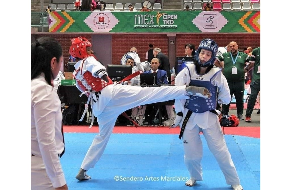 Jamaica's Shauna-Kay Hines (left) strikes a blow against an opponent in action from the Mexico Open TKD.