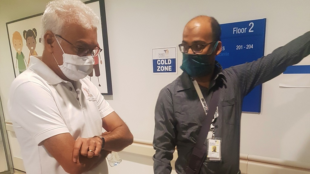 Photo: Dr Kevin Khan-Kernahan , Head of the Adult ICU at the Couva Hospital and Multi-Training Facility guides the Health Minister Terrence Deyalsingh through a tour of the 'cold' areas of the facility. Photo courtesy the Ministry of Health.