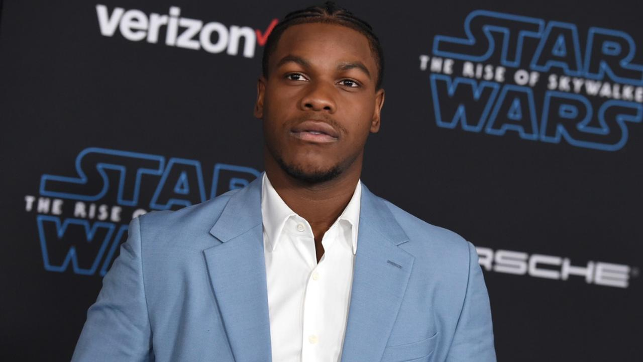 "In this Monday, December 16, 2019 file photo, John Boyega arrives at the world premiere of ""Star Wars: The Rise of Skywalker"" in Los Angeles. British perfume brand Jo Malone has apologized to Black actor John Boyega of ""Star Wars"" fame after cutting him out of the Chinese version of a cologne commercial he helped create. (Jordan Strauss/Invision/AP, File)"