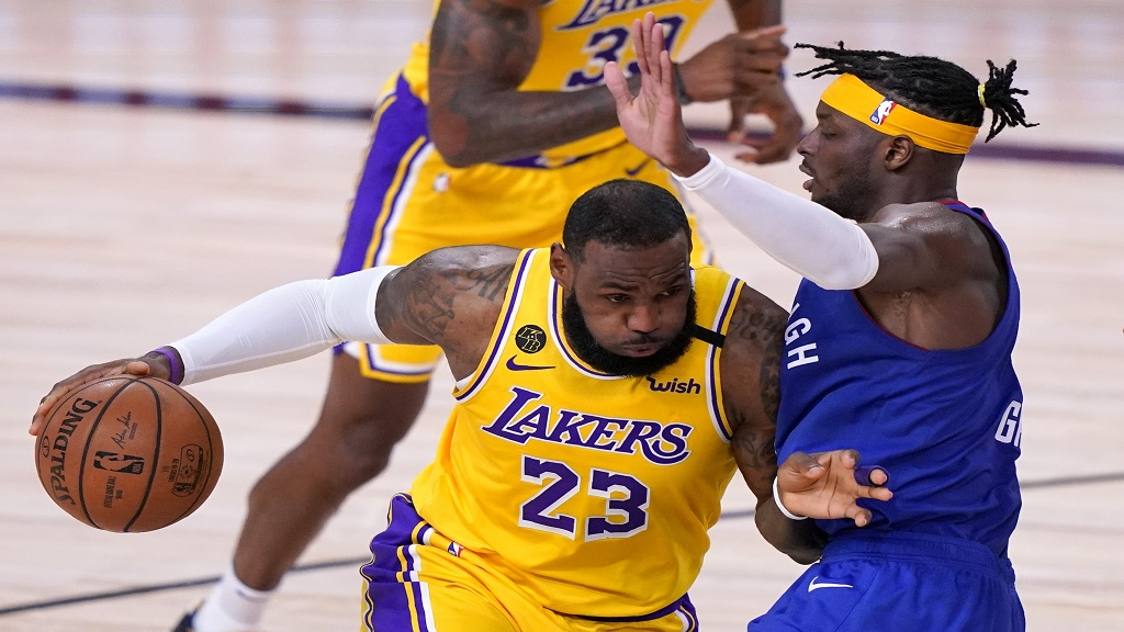 Los Angeles Lakers forward LeBron James (23) works against Denver Nuggets forward Jerami Grant, right, to advance the ball up court during the second half an NBA conference final playoff game, Friday, Sept. 18, 2020, in Lake Buena Vista, Fla. (AP Photo/Mark J. Terrill).
