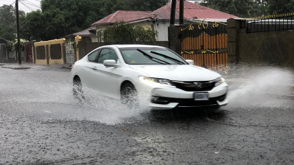 A motorist braving the heavy rains on Wednesday afternoon.