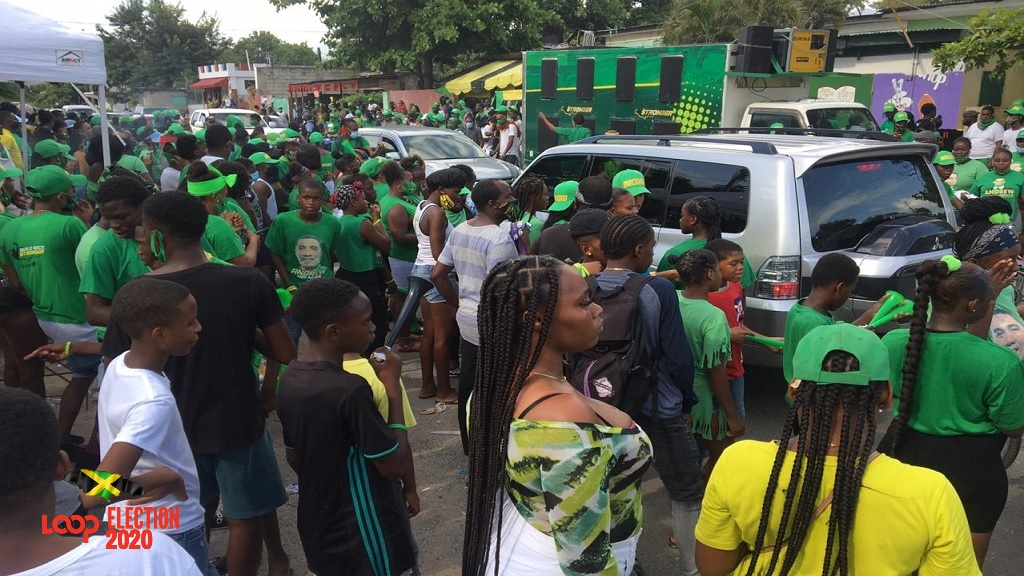 Labourites gather amid a party-like atmosphere in West Central St Andrew on Election Day.