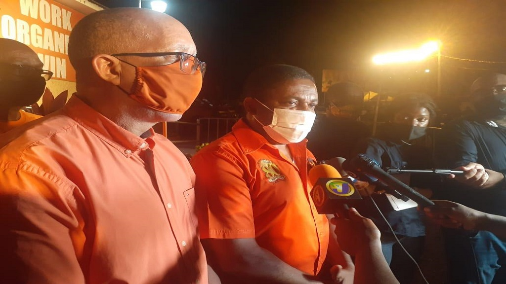 People's National Party (PNP) Vice-President, Phillip Paulwell (centre) addressing the media at the party's headquarters in St Andrew after the Jamaica Labour Party's landslide victory in the September 3 General Elections.