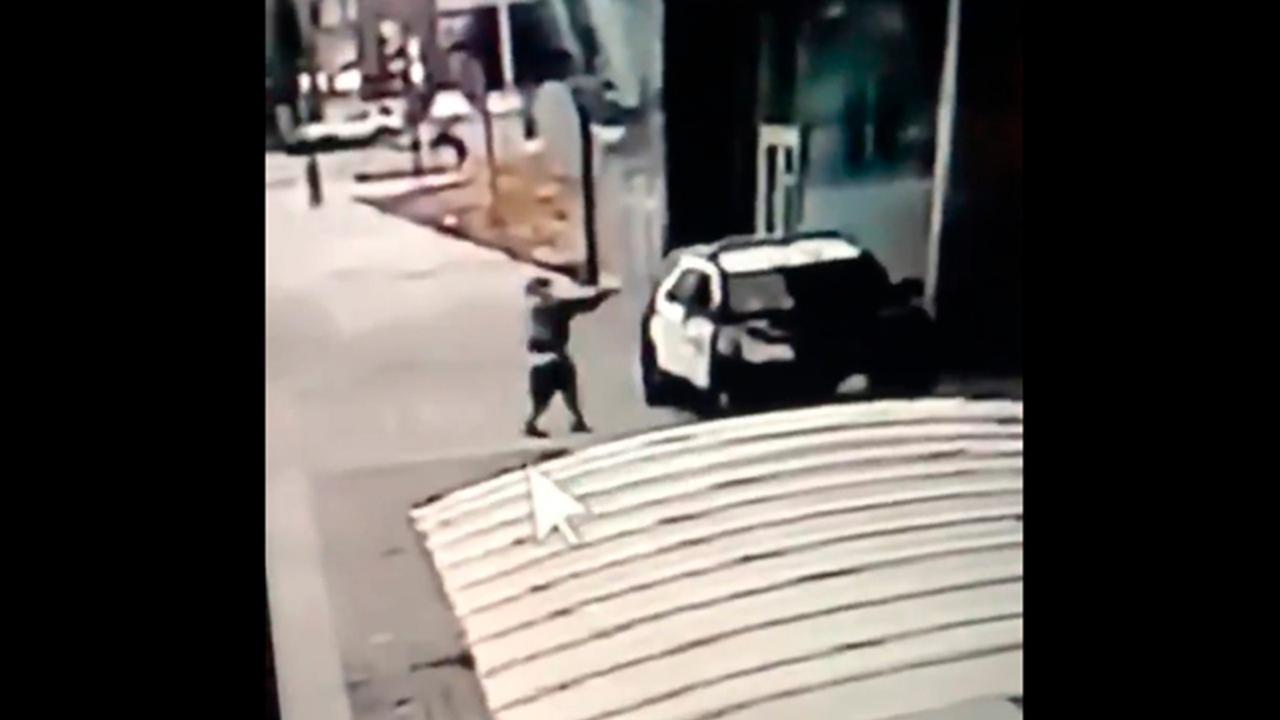 A screen grab from a security camera video released the Los Angeles County Sheriff's Department shows a gunman walking up to sheriff's deputies and opening fire without warning or provocation in Compton, California, on Saturday, September 12, 2020. (Los Angeles County Sheriff's Department via AP)