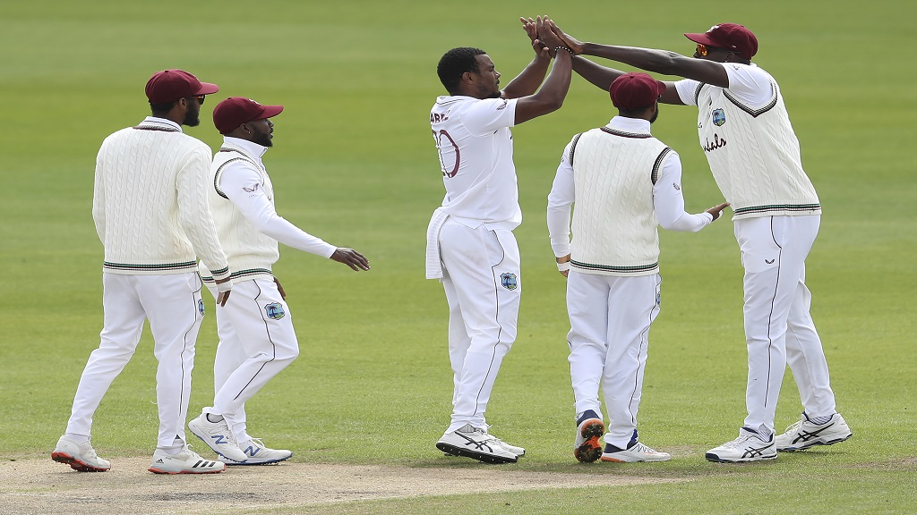 West Indies' Shannon Gabriel, centre celebrates with teammates the dismissal of England's Jos Buttler during the second day of the third cricket Test match at Old Trafford in Manchester, England, Saturday, July 25, 2020. (Martin Rickett/Pool via AP).