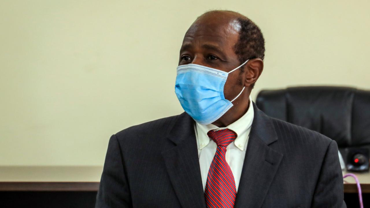 "Paul Rusesabagina appears in front of media at the headquarters of the Rwanda Bureau of investigations building in Kigali, Rwanda Monday, Aug. 31, 2020. Rusesabagina, who was portrayed in the film ""Hotel Rwanda"" as a hero who saved the lives of more than 1,200 people from the country's 1994 genocide, and is a well-known critic of President Paul Kagame, has been arrested by the Rwandan government on terror charges, police announced on Monday, Aug. 31, 2020. (AP Photo)"