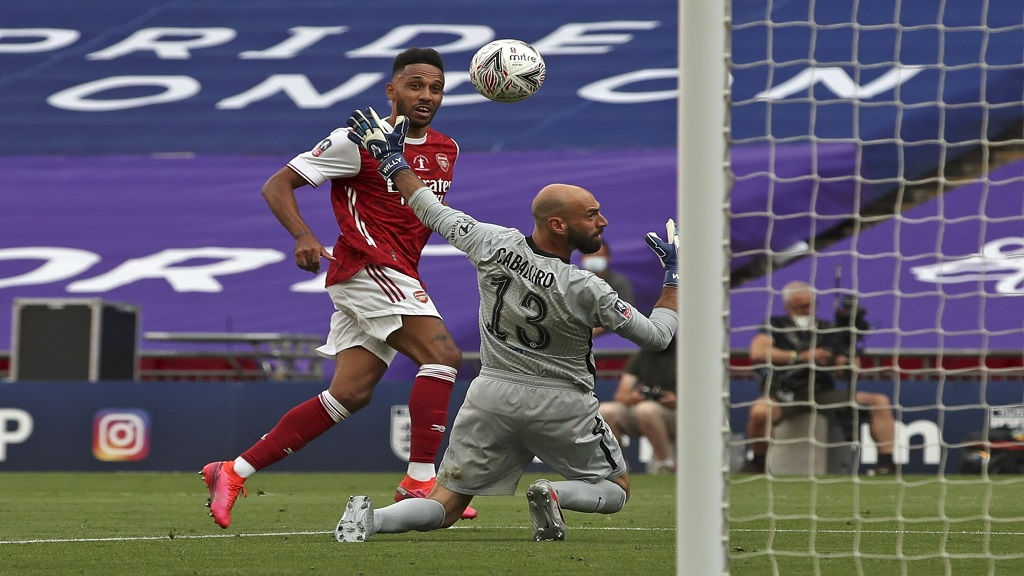 Arsenal's Pierre-Emerick Aubameyang scores his side's second goal during the FA Cup final  against Chelsea at Wembley stadium in London, England, Saturday, Aug. 1, 2020. (Adam Davy/Pool via AP).