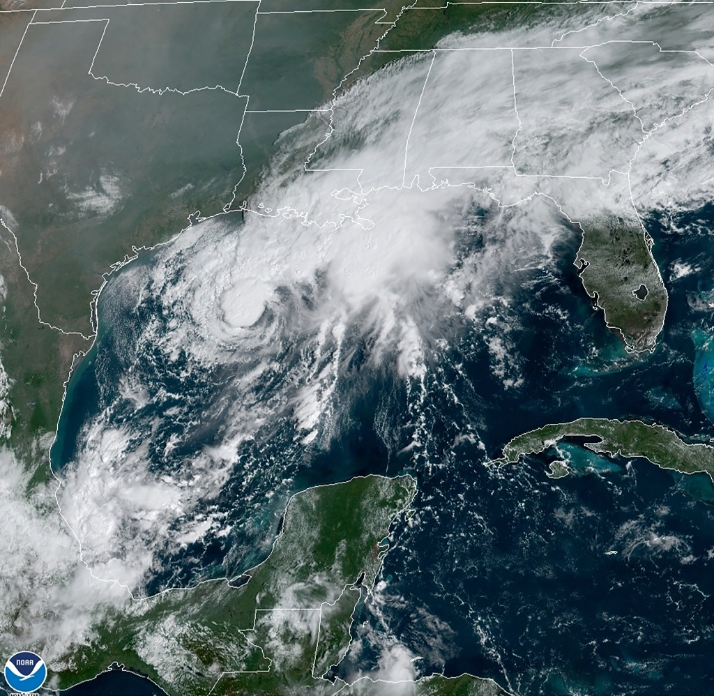 This GOES-16 GeoColor satellite image taken Saturday, September 19, 2020, and provided by NOAA, shows Tropical Storm Beta, center, in the Gulf of Mexico. A hurricane watch is in effect Saturday for coastal Texas as Tropical Storm Beta gains strength. A storm surge watch and a tropical storm watch are also in effect for the area during an exceptionally busy Atlantic hurricane season. (NOAA via AP)