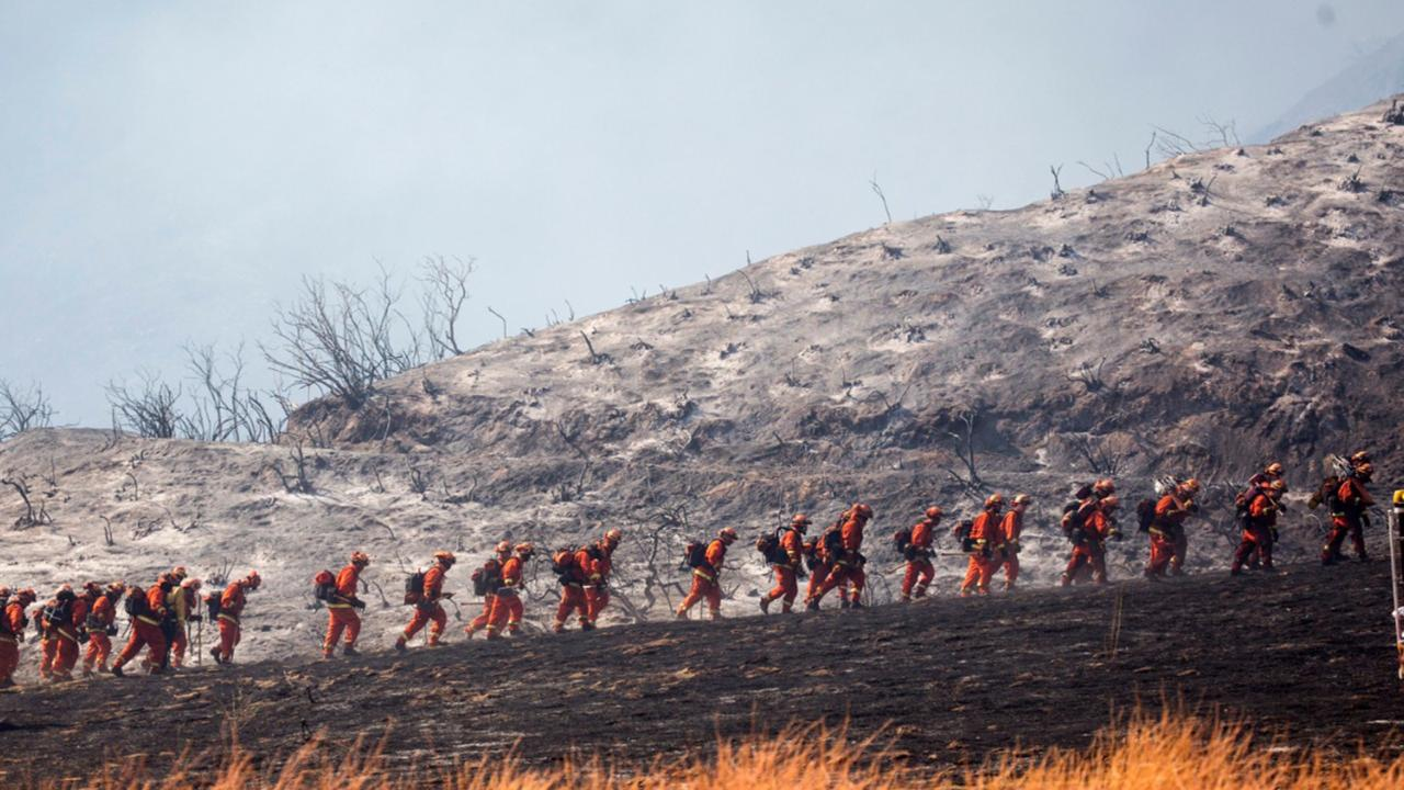 Members of a hand crew work on the fire line in Yucaipa, Calif., Saturday, Sept. 5, 2020. (AP Photo/Ringo H.W. Chiu)
