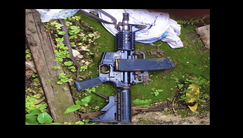 M15 rifle found buried in the ground at the rear of a premises in St James