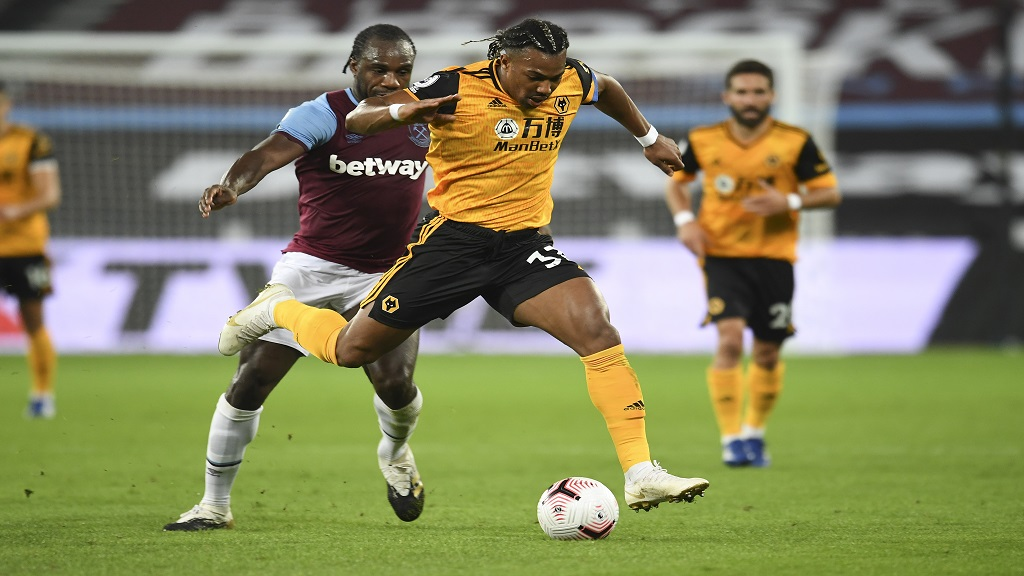 Wolverhampton Wanderers' Adama Traore, right, battles for the ball with West Ham's Angelo Ogbonna during their English Premier League football match at London Stadium, London, England, Sunday, Sept. 27, 2020. (Andy Rain/Pool via AP).