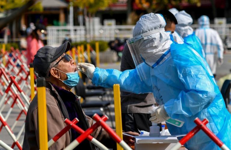 Dépistage massif à Qingdao après la découverte de six as de Covid-19, le 12 octobre, dans l'est de la Chine afp.com - STR