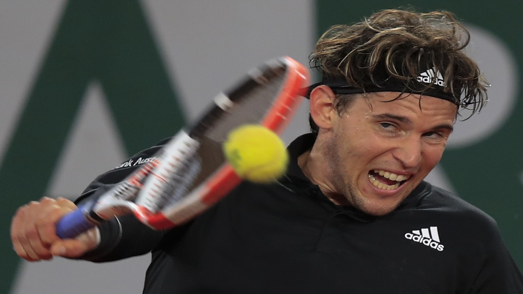 Austria's Dominic Thiem plays a shot against Norway's Casper Ruud in the third round match of the French Open tennis tournament at the Roland Garros stadium in Paris, France, Friday, Oct. 2, 2020. (AP Photo/Michel Euler).