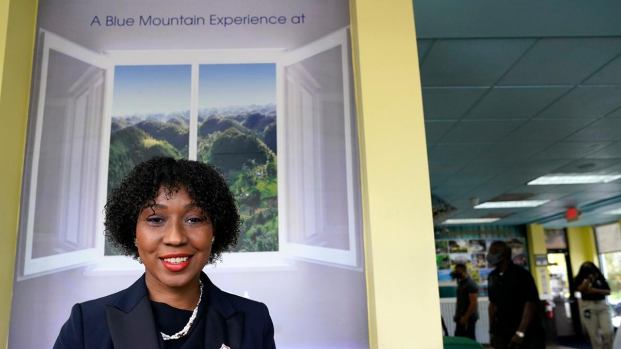 In this August 26, 2020, photo Florida Representative Anika Omphroy poses for a photograph at the Dutch Pot Jamaican Restaurant in Pembroke Pines. (AP Photo/Lynne Sladky)