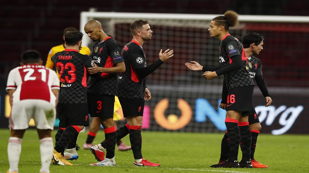 Liverpool's players celebrate their victory following the group D Champions League football match against Ajax at the Johan Cruyff ArenA in Amsterdam, Netherlands, Wednesday, Oct. 21, 2020. Liverpool won the match 1-0. (AP Photo/Peter Dejong).