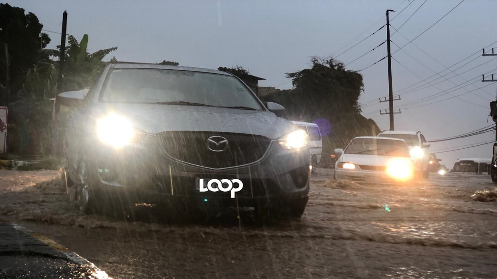 Motorists brave heavy rains in the Bull Bay section of St Andrew on Friday morning.