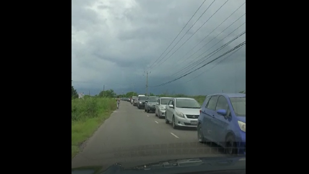 Traffic gridlock along the Hellshire main road in St Catherine on Sunday as motorists attempt to get off the road before the 3pm national curfew.