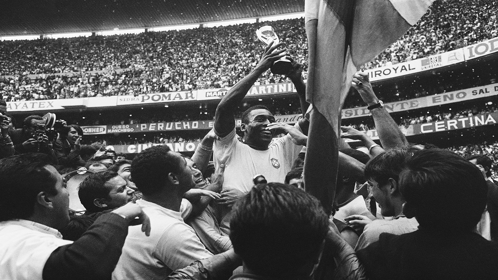 In this June 21, 1970 file photo, Brazil's Pele holds up his team's Jules Rimet Trophy, or the FIFA World Cup Trophy, following Brazil's 4-1 victory over Italy at the World Cup at the Azteca Stadium in Mexico City. (AP Photo, File).