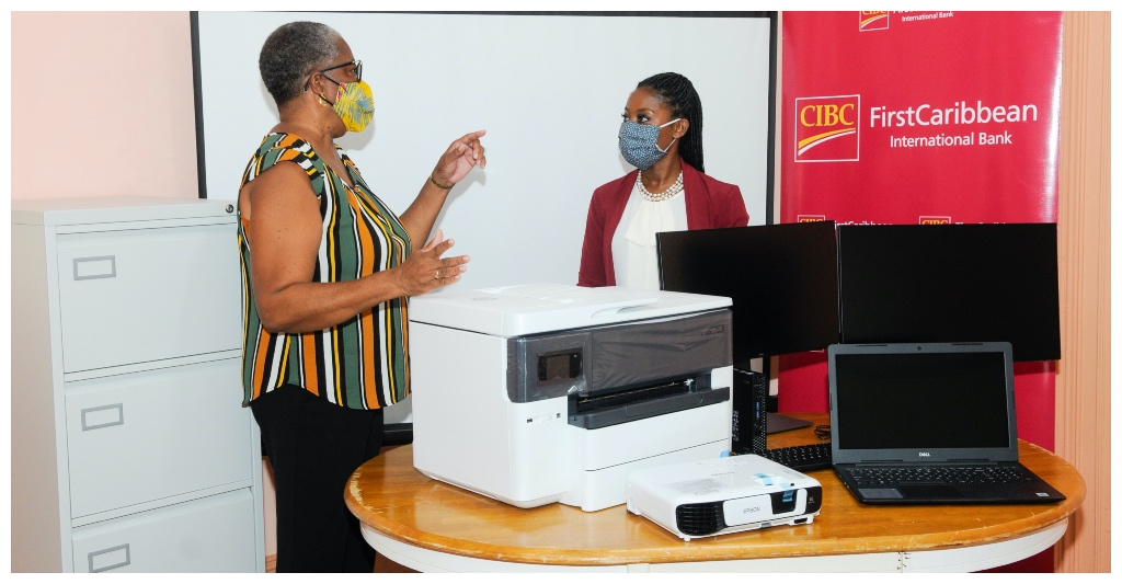 (From Left) Deputy Principal Juliette Cumberbatch explains how the equipment will be used to Samantha Suttle Marketing Manager Barbados OpCo immediately following the presentation at the Cane Field location