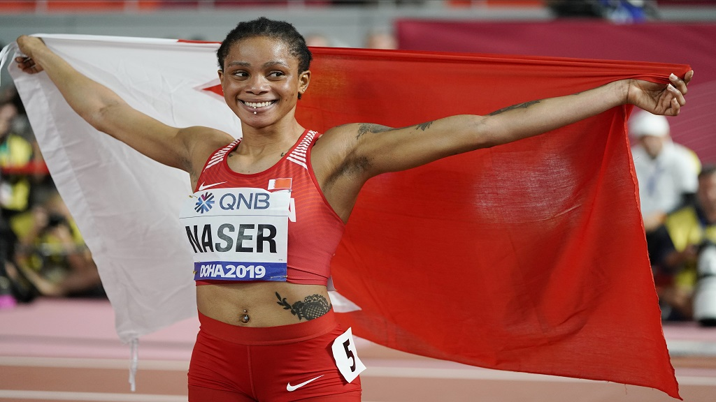 In this Oct. 3, 2019, file photo, Salwa Eid Naser, of Bahrain, celebrates after winning gold in the women's 400-metre final at the World Athletics Championships in Doha, Qatar.