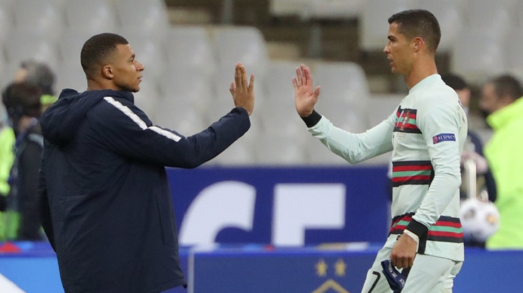 FILE - In this Sunday, Oct. 11, 2020 file photo France's Kylian Mbappe and Portugal's Cristiano Ronaldo, right, greet each other before the UEFA Nations League soccer match between France and Portugal at the Stade de France in Saint-Denis, north of Paris, France. The Portuguese soccer federation says Cristiano Ronaldo has tested positive for the coronavirus.  (AP Photo/Thibault Camus, File)
