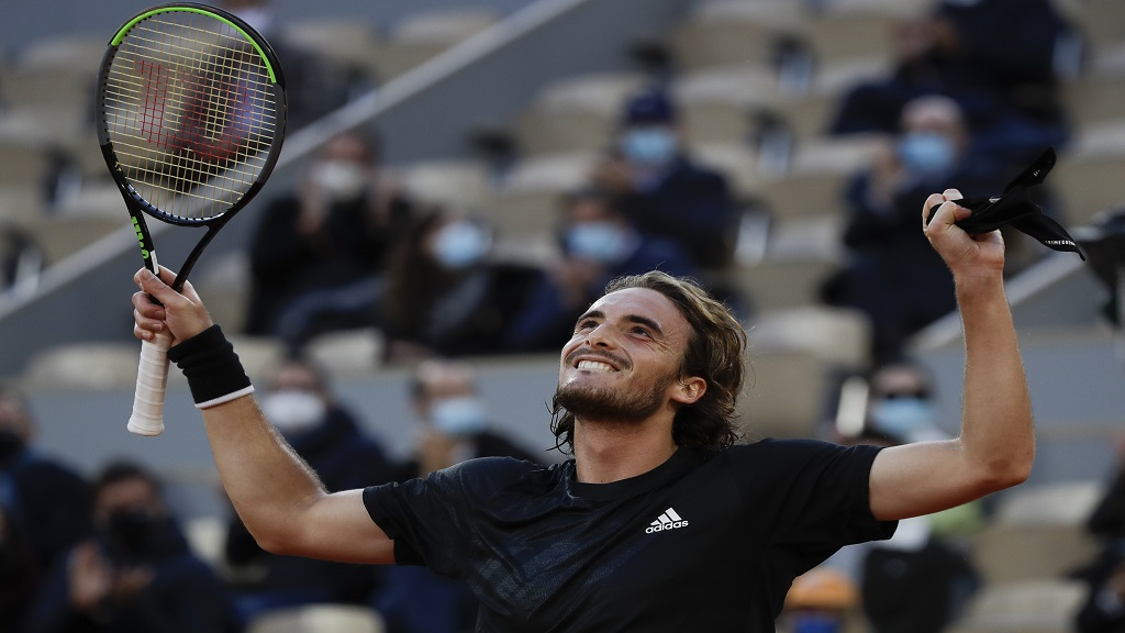 Greece's Stefanos Tsitsipas celebrates winning his quarterfinal match of the French Open tennis tournament against Russia's Andrey Rublev in three sets, 7-5, 6-2, 6-3, at the Roland Garros stadium in Paris, France, Wednesday, Oct. 7, 2020. (AP Photo/Alessandra Tarantino).