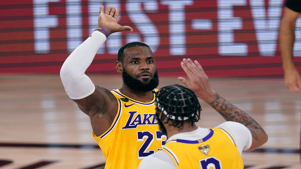 Los Angeles Lakers' LeBron James (23) high-fives Anthony Davis during the second half of Game 1 of basketball's NBA Finals Wednesday, Sept. 30, 2020, in Lake Buena Vista, Fla. (AP Photo/Mark J. Terrill).