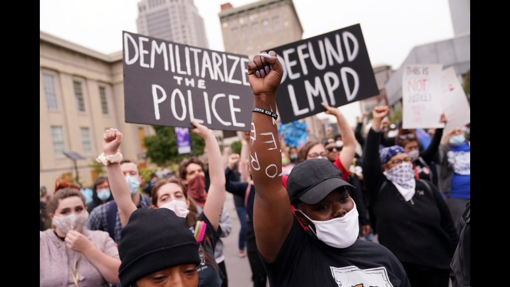 In this September 23, 2020, file photo, protesters speak in Louisville. Hours of material in the grand jury proceedings for Taylor's fatal shooting by police have been made public on Friday, October 2. Photo: AP Photo/John Minchillo, File