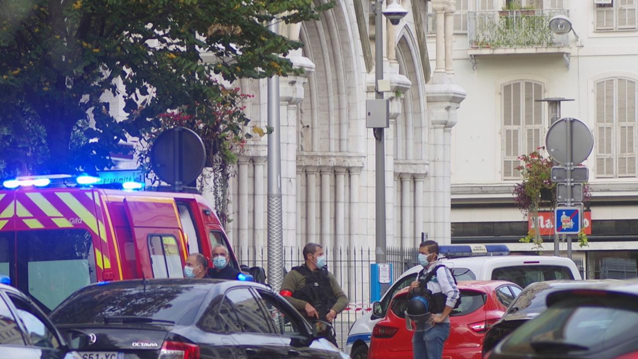 French policemen stand next to Notre Dame church after a knife attack, in Nice, France, Thursday, October 29, 2020. French anti-terrorism prosecutors are investigating a knife attack at a church in the Mediterranean city of Nice that killed two people and injured several others. (AP Photo/Alexis Gilli)