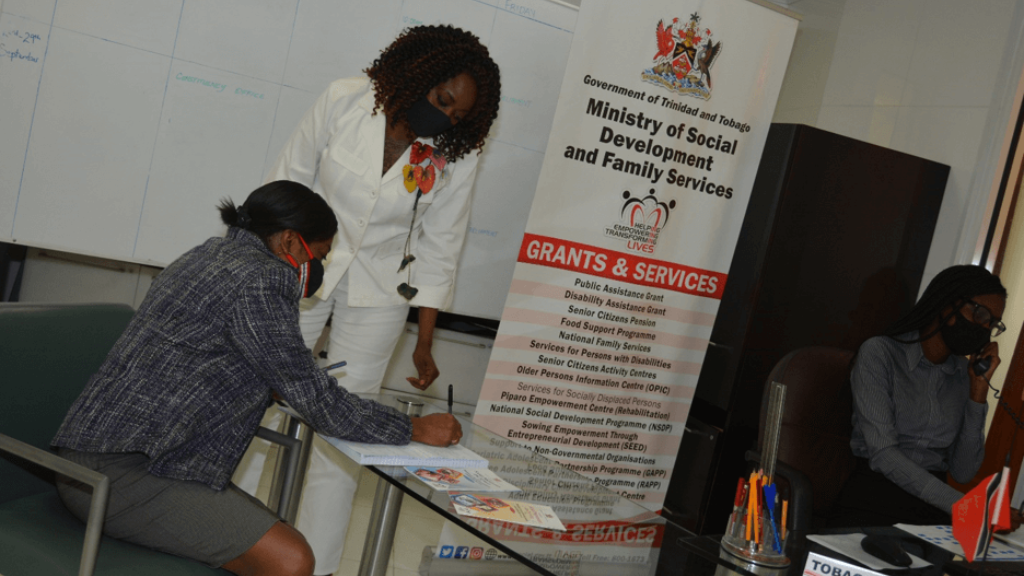 Photo: Minister Donna Cox engages with staff at the Ministry of Social Development's newly launched Tobago Help Desk. Credit: Ministry of Social Development and Family Services.