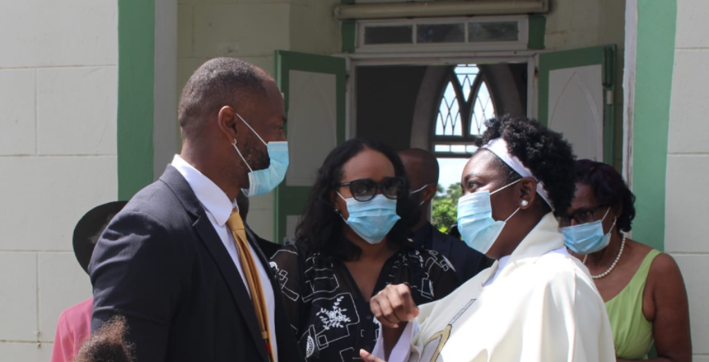 Democratic Labour Party (DLP) candidate for St George North Floyd Reifer, speaks to Reverend Yolanda Clarke (far right) while accompanied by his daughter Victoria (far left) and his wife Amanda (centre).
