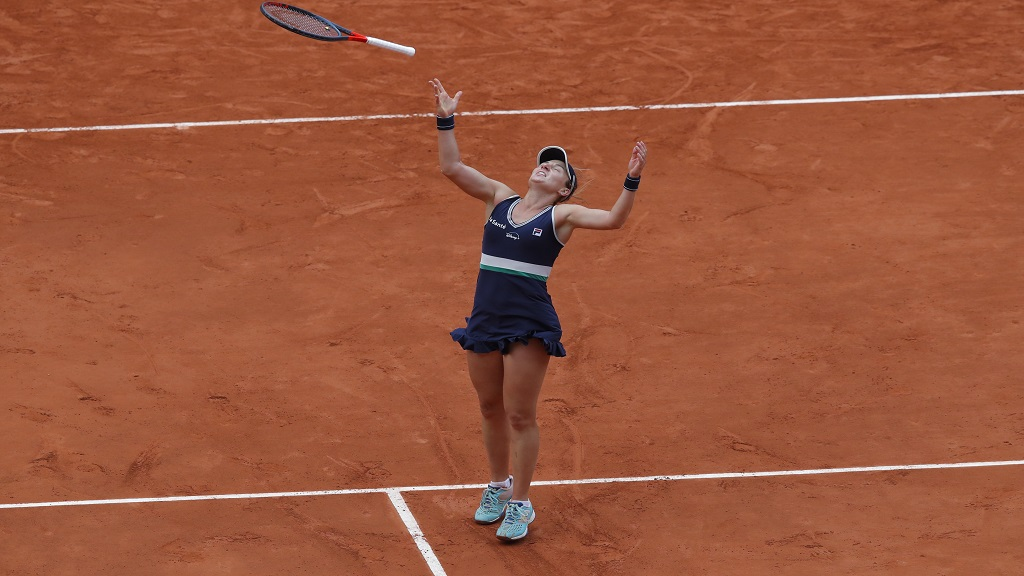 Argentina's Nadia Podoroska throws her racket in the air as she celebrates winning the quarterfinal match of the French Open tennis tournament against Ukraine's Elina Svitolina in two sets, 6-2, 6-4, at the Roland Garros stadium in Paris, France, Tuesday, Oct. 6, 2020. (AP Photo/Michel Euler).