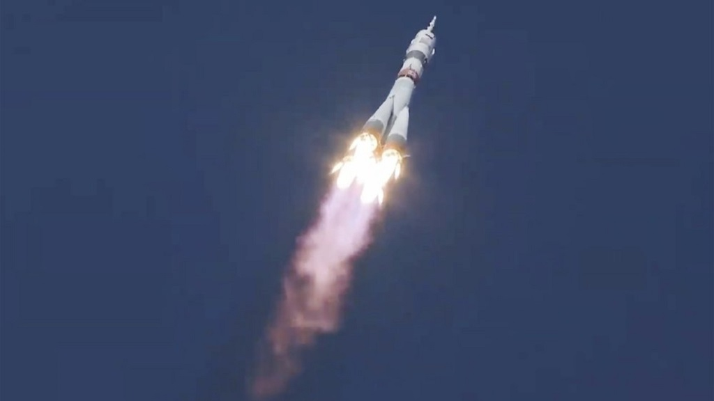 In this image made from video footage released by Roscosmos Space Agency, the Soyuz-2.1a rocket booster with the Soyuz MS-17 space ship carrying a new crew to the International Space Station (ISS), blasts off at the Russian leased Baikonur cosmodrome, Kazakhstan, Wednesday, Oct. 14, 2020. A trio of space travelers has launched successfully to the International Spce Station, for the first time using a fast-track maneuver to reach the orbiting outpost in just three hours. (Roscosmos Space Agency via AP)