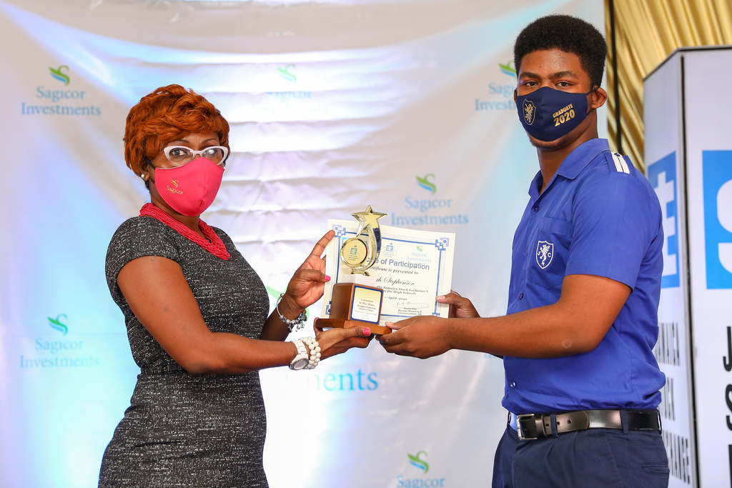 Shelly-Ann Morgan (left), Manager – Investment Client Services, Sagicor Investments Jamaica presents Juvaughn Stephenson, first place winner for the 2019 staging of the Jamaica Stock Exchange (JSE) Stock Market Game for High Schools at a recent presentation ceremony held at the JSE.