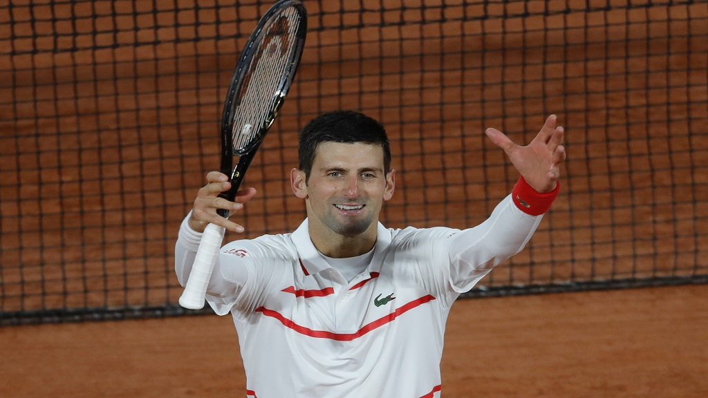 Serbia's Novak Djokovic celebrate winning his third round match of the French Open tennis tournament against Colombia's Daniel Elahi Galan in three sets 6-0, 6-3, 6-3, at the Roland Garros stadium in Paris, France, Saturday, Oct. 3, 2020. (AP Photo/Christophe Ena).